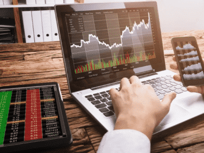 Trader works with laptop