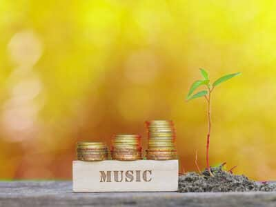 MUSIC WORD Golden coin stacked with wooden bar on shallow DOF