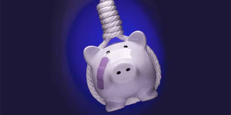 Piggy Bank with Bandage Hanging in Hangman's Noose