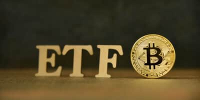 Bitcoin coin with ETF text on stone background, Concept Entering the Digital Money Fund. ETF and Bitcoin concept
